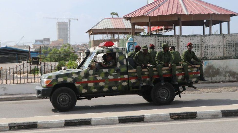 Somali government soldiers on a Military vehicle are seen outside the SYL hotel in Mogadishu on December 11, 2019