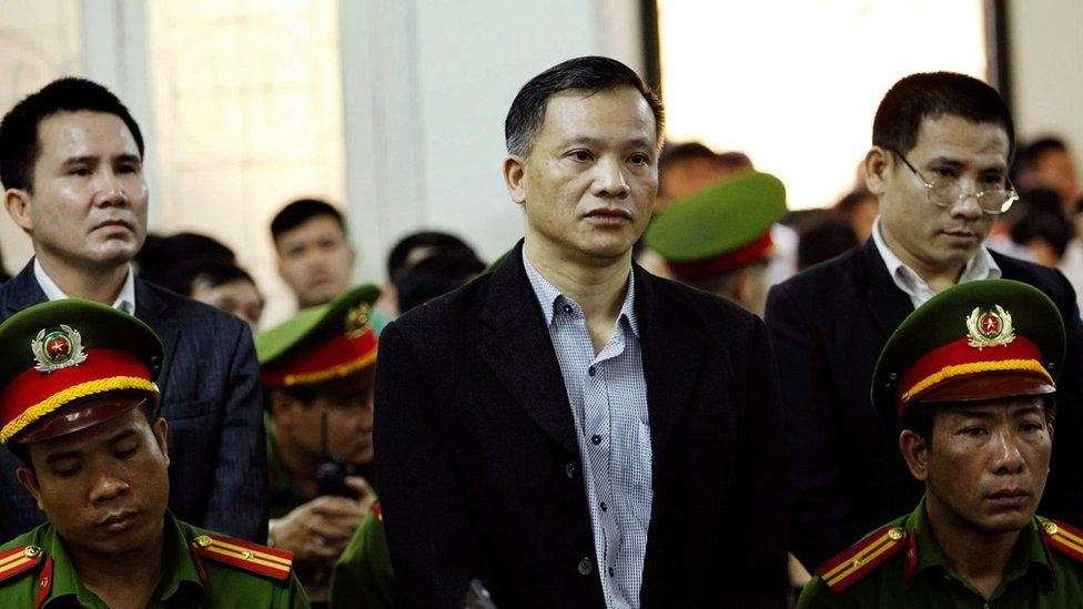 Prominent Vietnamese lawyer Nguyen Van Dai stands during the trial in Hanoi on 5 April 2018
