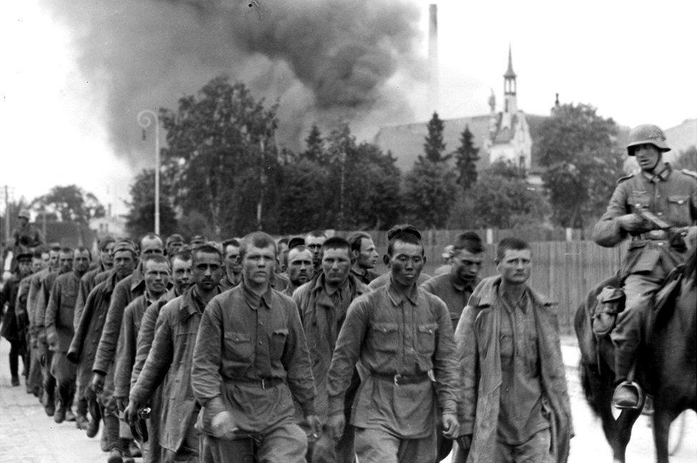 Germans with Soviet POWs, Riga, July 1941