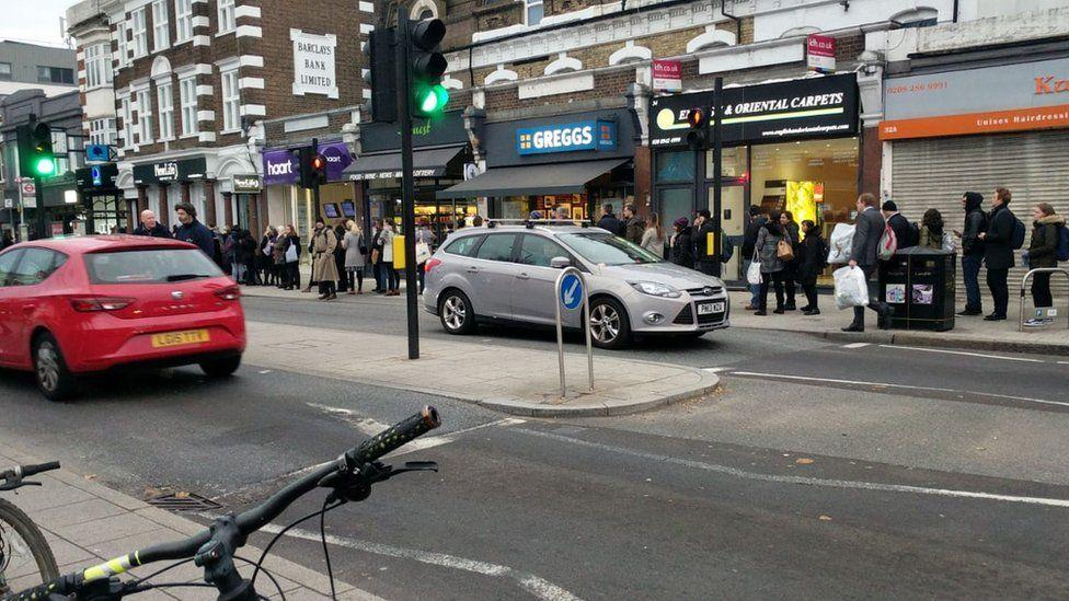 Big queue going down a street