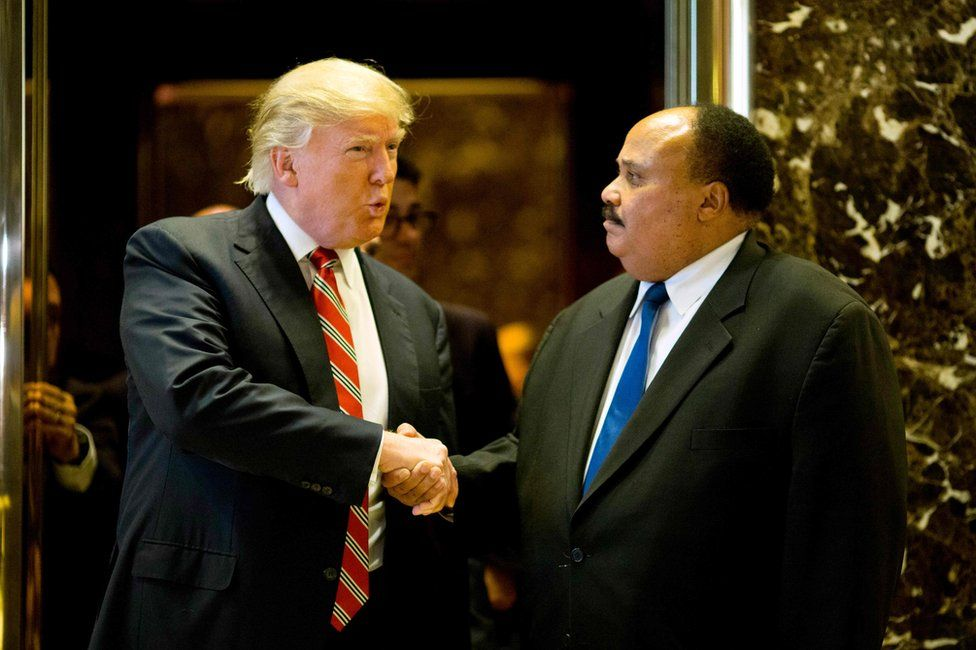 US President-elect Donald Trump shakes hands with Martin Luther King III after meeting at Trump Tower in New York City, 16 January