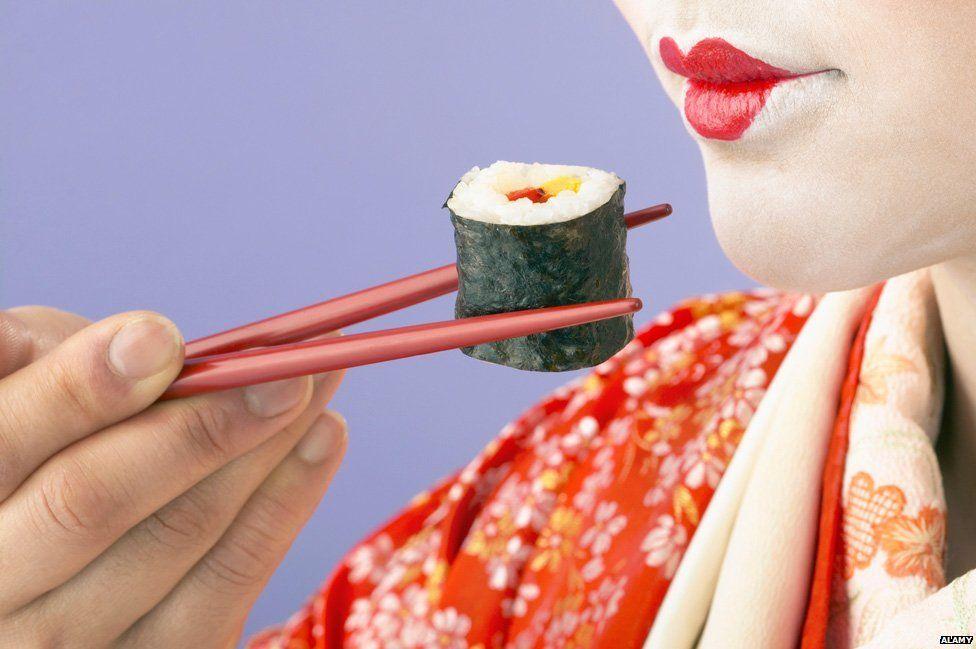 Geisha eats a sushi roll