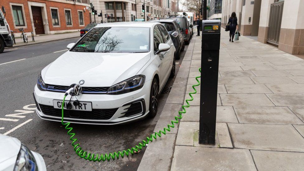 An electric car is seen charging at a charging point on the street in Westminster, central London, UK on January 11, 2019
