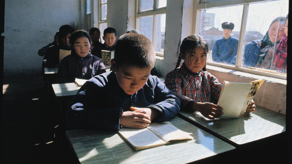 General view of children attending class in a Peking school during the time of President Nixon's visit to China.