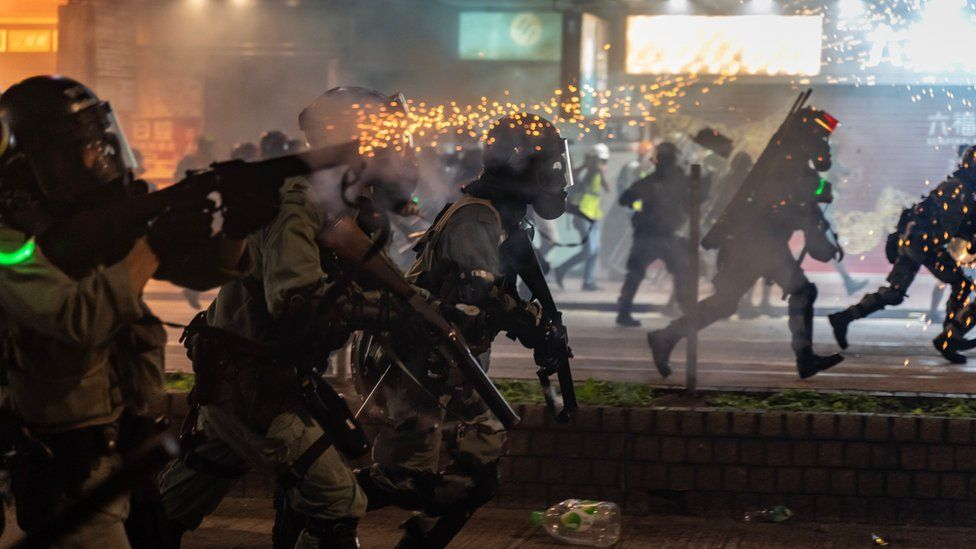 Riot police fire teargas as they charge on a street on November 2, 2019 in Hong Kong, China.