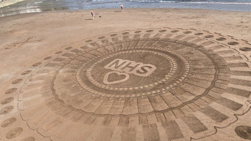 Sand art for the NHS on Torquay beach