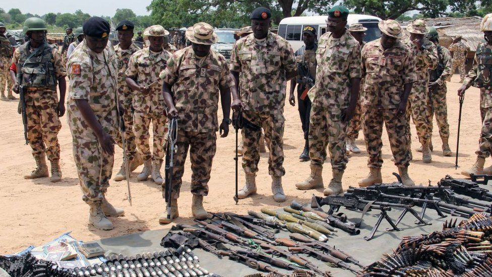Military commanders inspect arms and ammunitions recovered from Boko Haram jihadists on display at the headquarters of the 120th Battalion in Goniri, Yobe State, in Nigeria's restive northeast on July 3, 2019