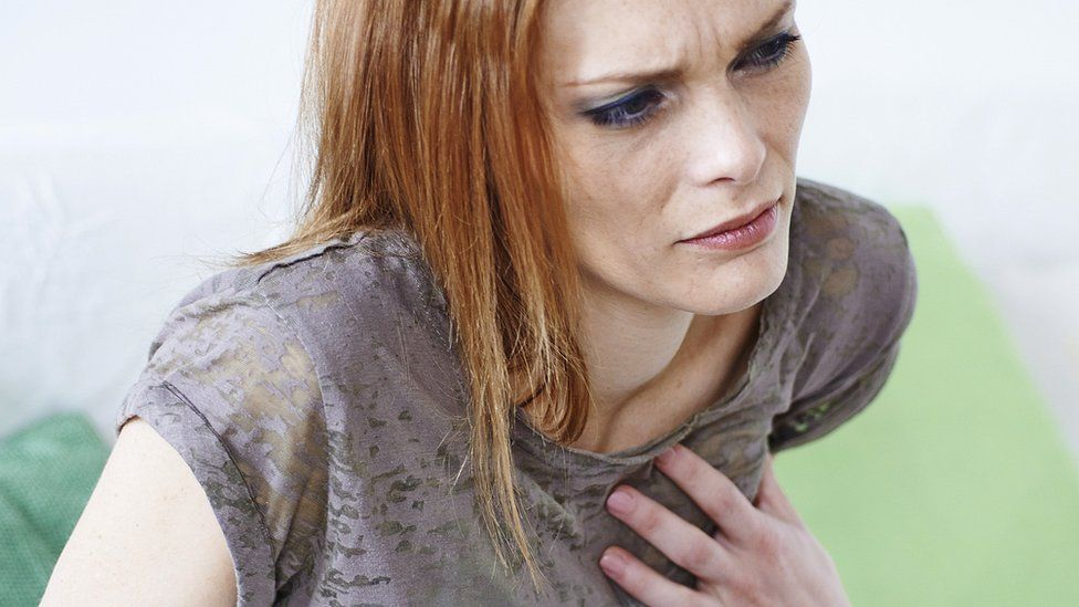 A woman having chest pain