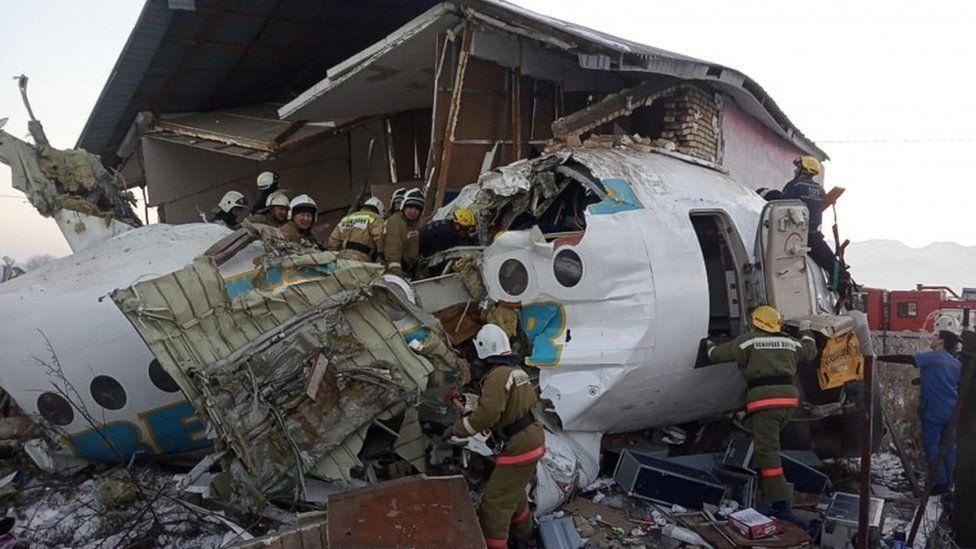 Emergency personnel at the site of a plane crash near Almaty, Kazakhstan, 27 December