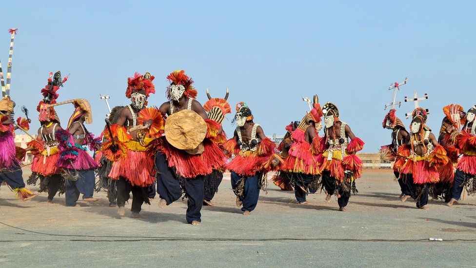 Masks performing their annual dance ritual in Mali's Dogon Land in Mopti