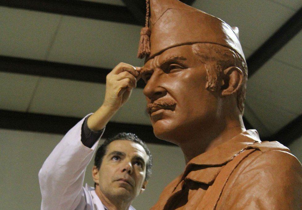 Sculptor working on legionnaire statue