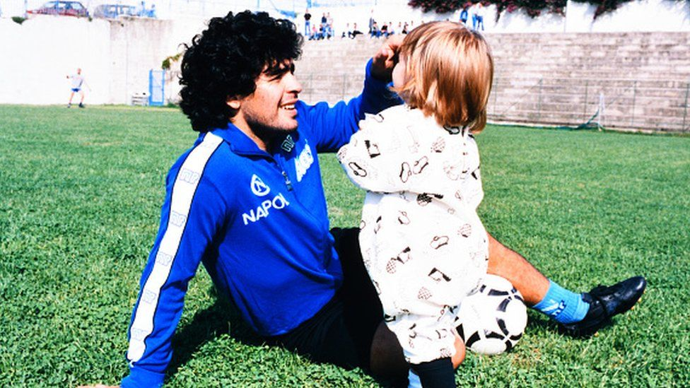 Maradona of Napoli plays with his daughter Dalma in 1989
