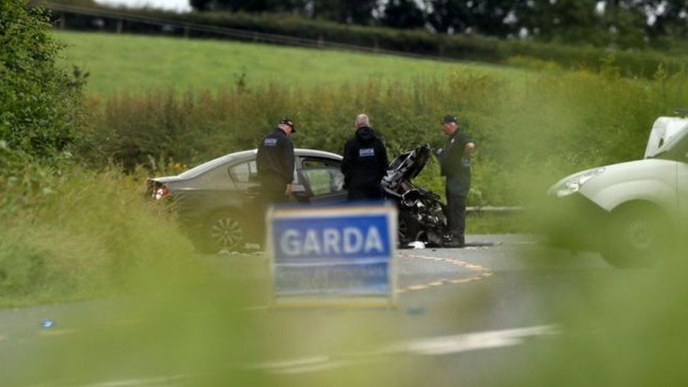 Garda (Irish police) examine one of the three vehicles involved in the fatal crash