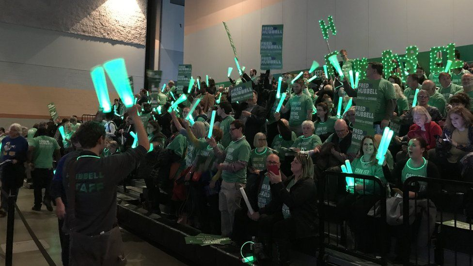 Fred Hubble supporter wave glowing sticks at the 2017 Iowa Fall Gala