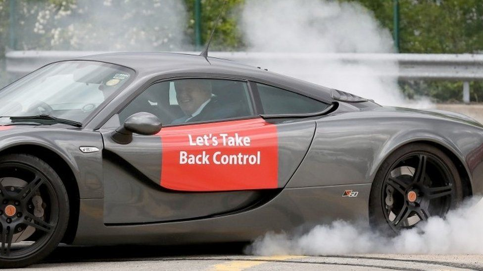 Boris Johnson takes a ride in a sports car
