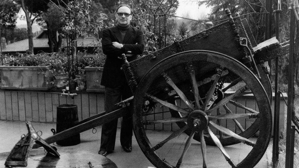 Ennio Morricone smiling in the garden. Rome, 1970s