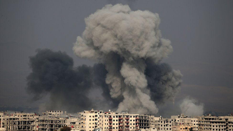 A picture taken on 20 February 2018 shows smoke plumes over the besieged Eastern Ghouta region in Syria