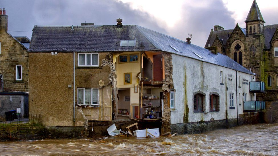 Part of the Bridge House Guest House and Sonia's Bistro in Hawick, Scotland, collapsed into the fast-flowing River Teviot as Storm Ciara battered the UK with high winds and heavy rain, 9 February 2020