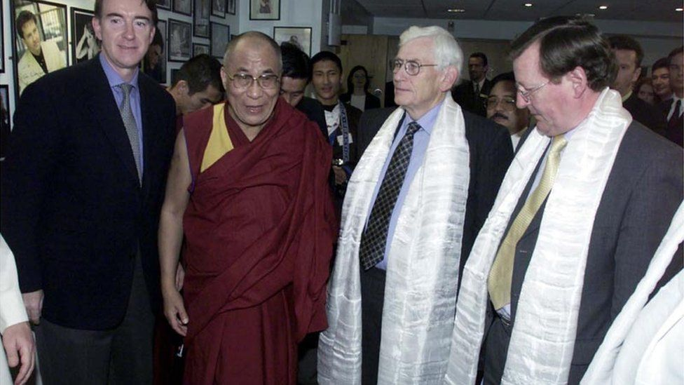 Mr Mallon argued with Peter Mandelson, pictured left of the Dalai Lama