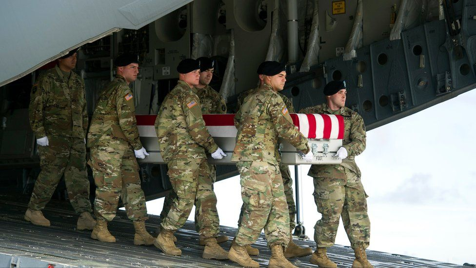 An Army carry team moves a transfer case containing the remains of Army Sgt Douglas Riney out of a transport aircraft on Friday 21 October 2016 at Dover Air Force Base, Delaware, USA.