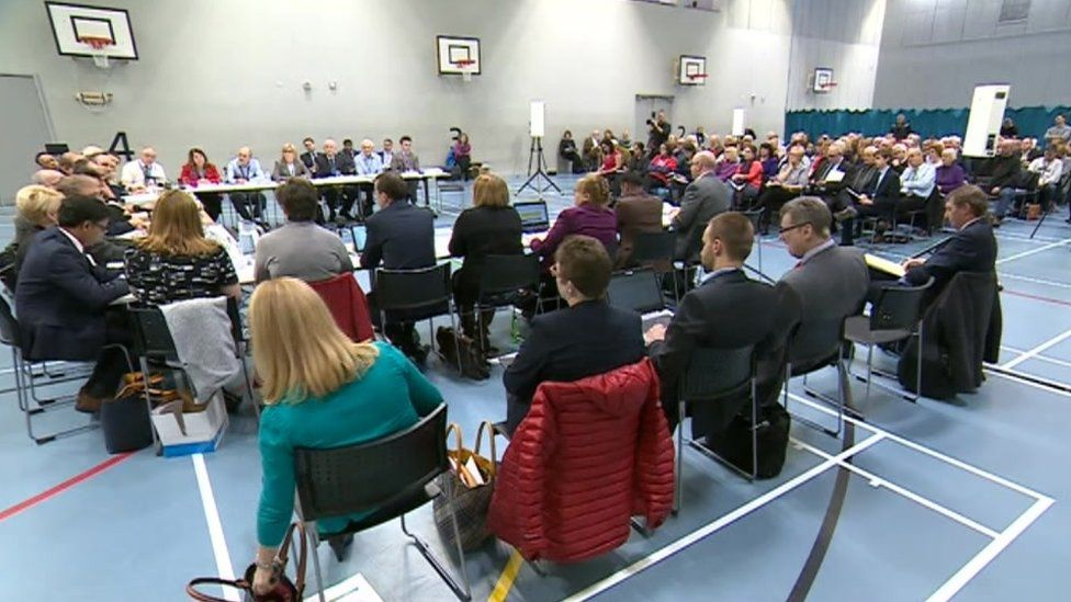 Health chiefs announce their decision at the public meeting