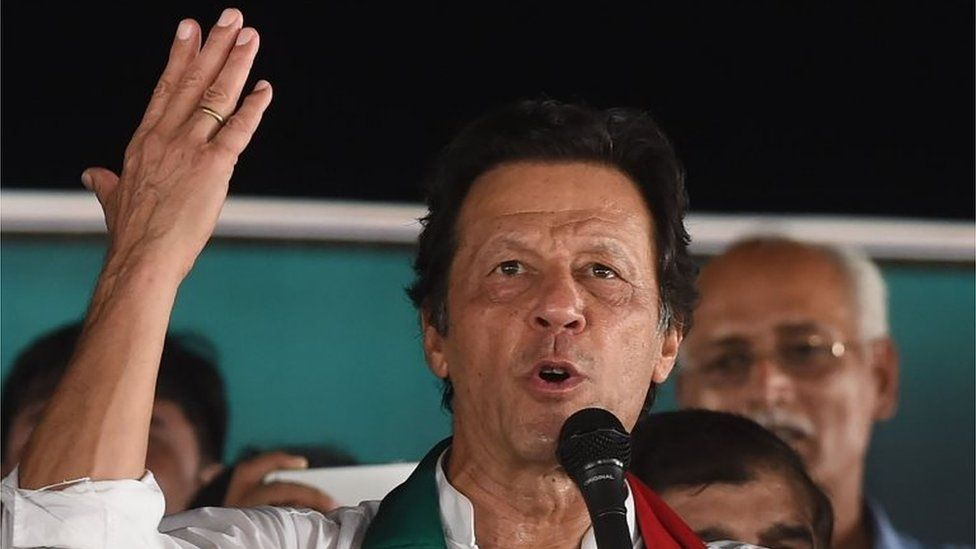 Pakistani cricket star-turned-politician and head of the Pakistan Tehreek-e-Insaf (PTI) Imran Khan gives a speech during a political campaign rally for the upcoming general election in Lahore on July 18, 2018.