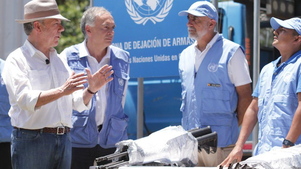 President Juan Manuel Santos (L) and Jean Arnault, Head of UN in Colombia (CL) August 15 2017