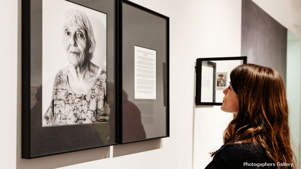 Young woman looking at Black and White photo