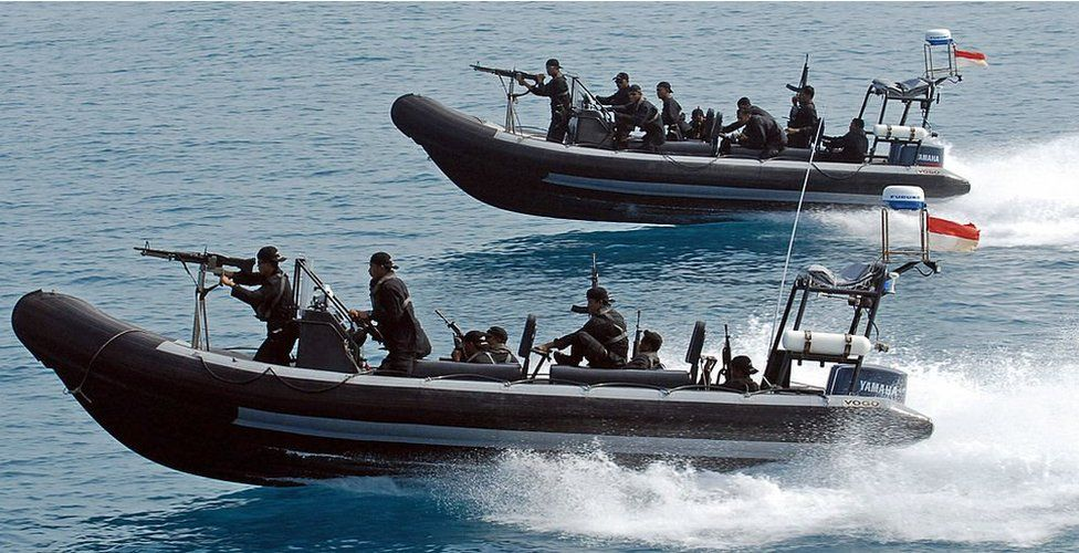 Indonesian marines sail armed speed boats during a simulation of the interception of a pirate ship - part of joint exercises with US navy seals off Sepa island, northern Jakarta, 27 July 2006.