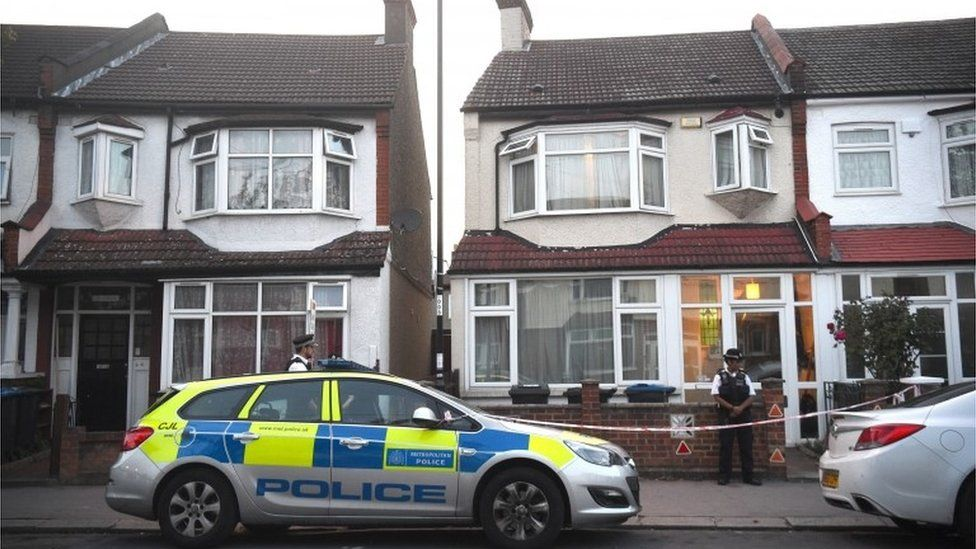 Police officers outside a property in Raymead Avenue