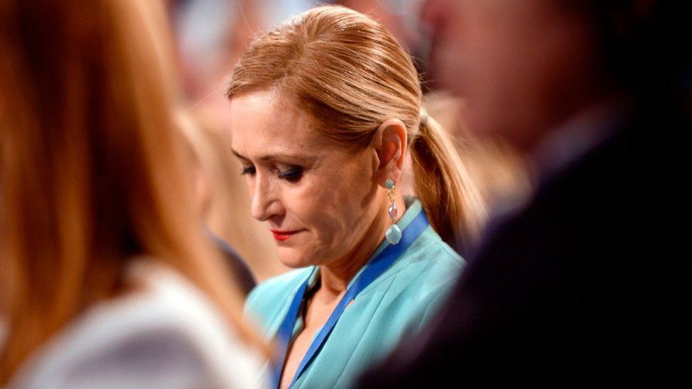 Cristina Cifuentes looks downwards