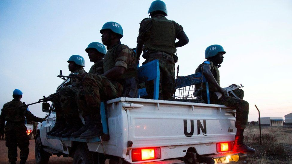 Peacekeeper troops from Ethiopia and deployed in the United Nations (UN) Interim Security Force for Abyei (UNISFA) patrol in a UN vehicle at night in Abyei town, Abyei state, on December 14, 2016.