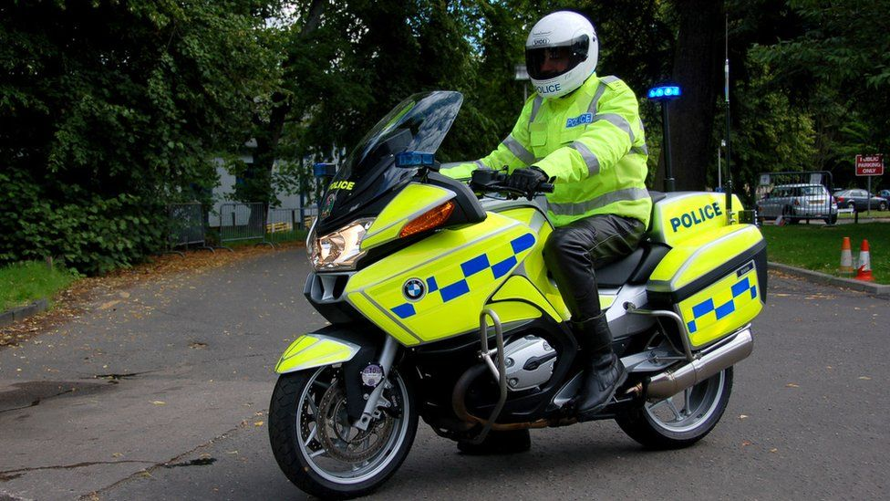 Police officer on motorbike