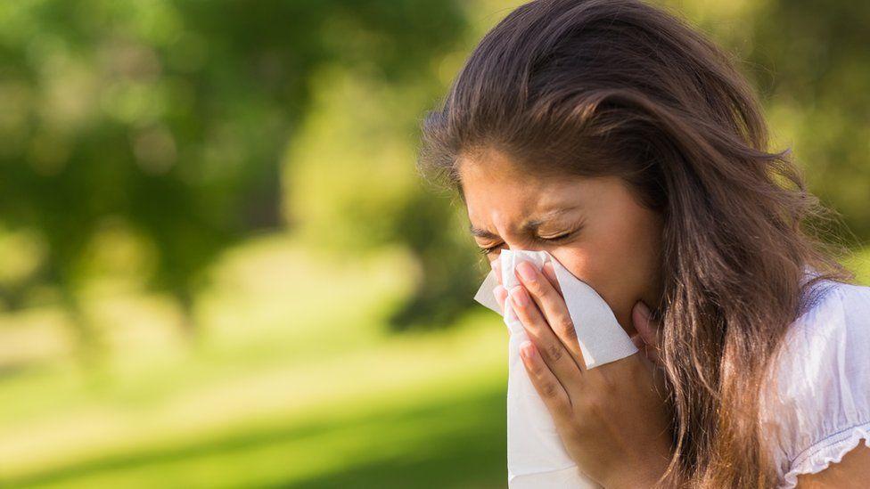 Image of a women sneezing