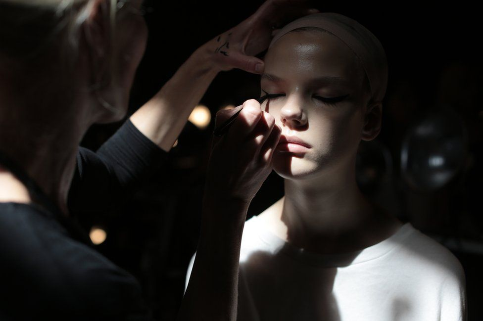 A model has her make-up applied backstage at the Marc Jacobs show as part of New York Fashion Week.