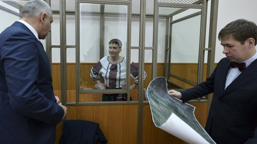Former Ukrainian army pilot Nadia Savchenko listens to her lawyers Mark Feygin (L) and Ilya Novikov during a court hearing in the southern border town of Donetsk in Rostov region, Russia, March 3, 2016