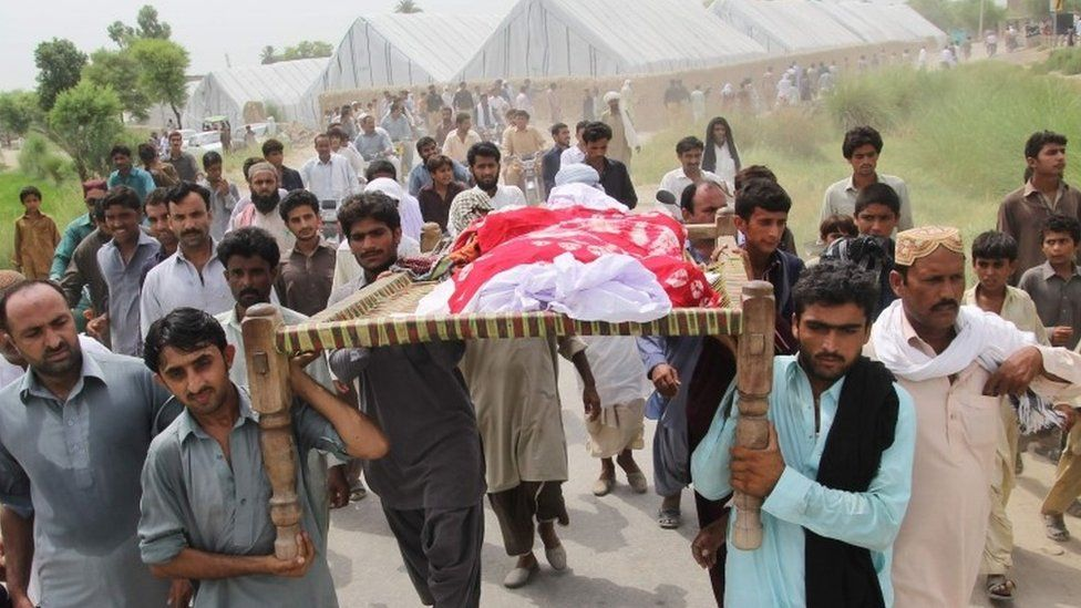 Pakistani relatives and residents carry the coffin of social media celebrity, Qandeel Baloch during her funeral in Shah Sadar Din village, around 130 kilometers from Multan on July 17, 2016.