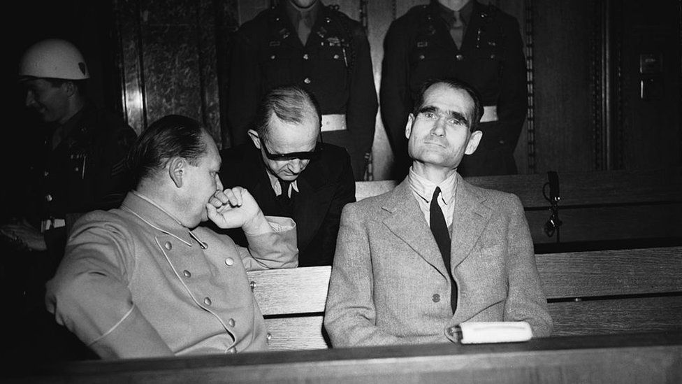 Hess at Nuremberg with Hermann Goering (l)