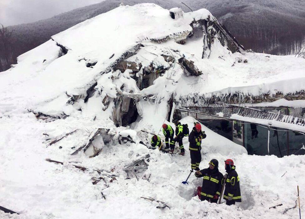Rescuers at the ruins of the Rigopiano Hotel, 19 January