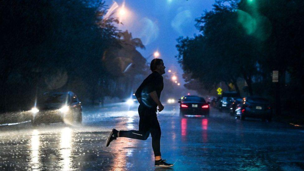 Man crosses street in Miami, Florida, on 8 November 2020