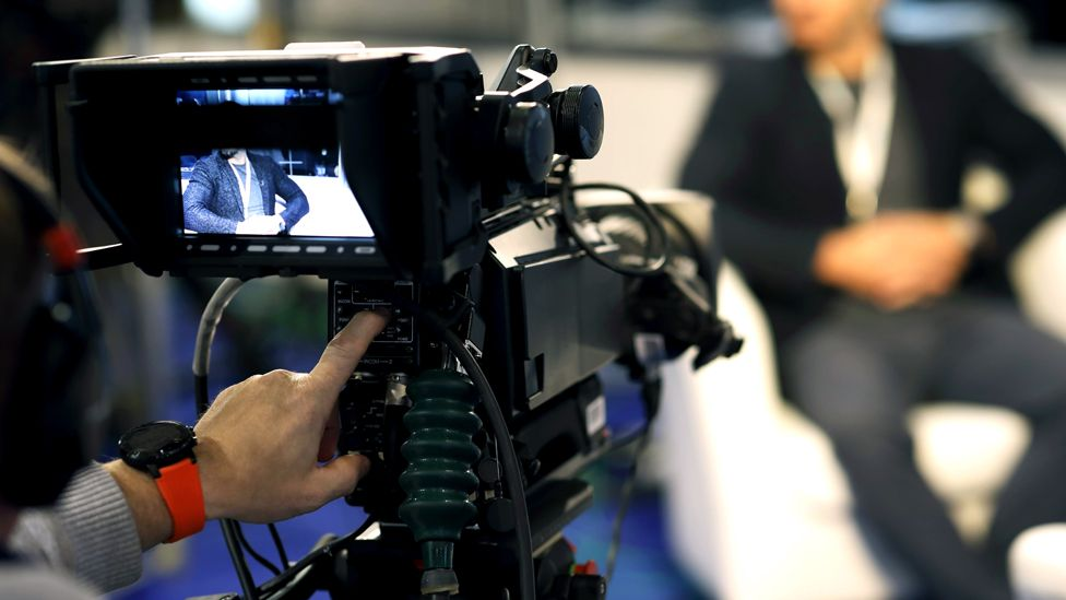 A TV camera films a programme