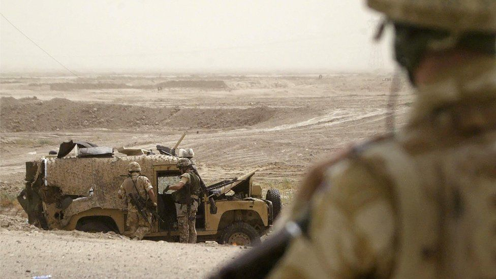 British troops inspect a Snatch Land Rover following a fatal roadside bombing in Basra, Iraq in September 2006