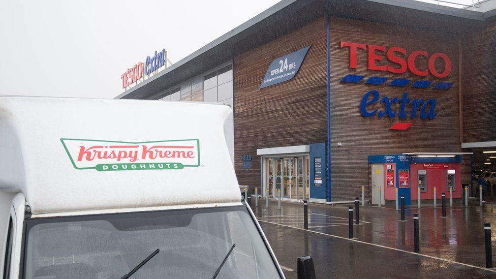 Krispy Kreme donut van outside Tesco Extra store in Wisbech