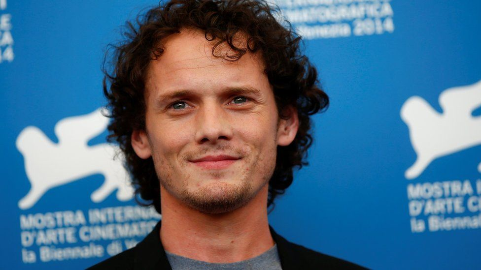Anton Yelchin poses during the photo call for the film Burying the ex at the 71st Venice Film Festival 4 September, 2014