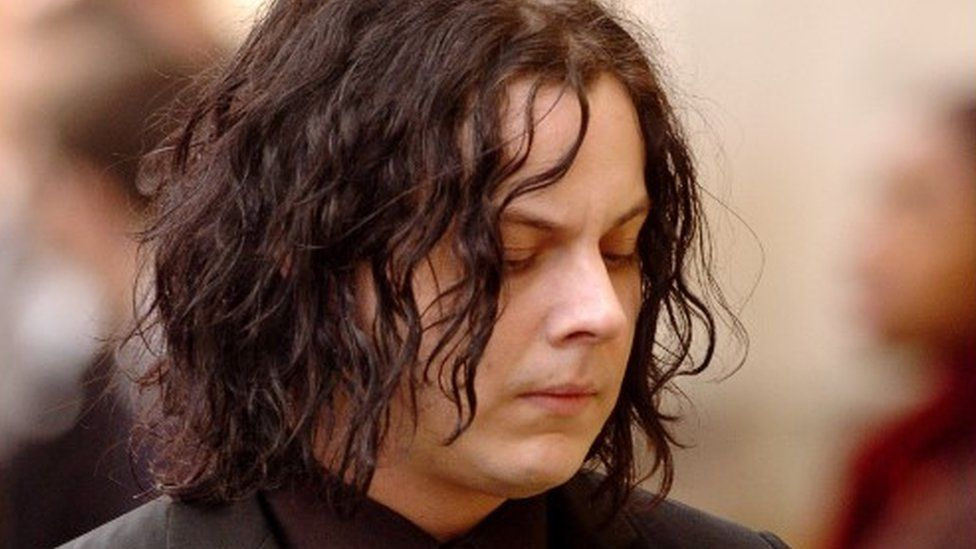 Jack White from The White Stripes attending John Peel's funeral in November 2004