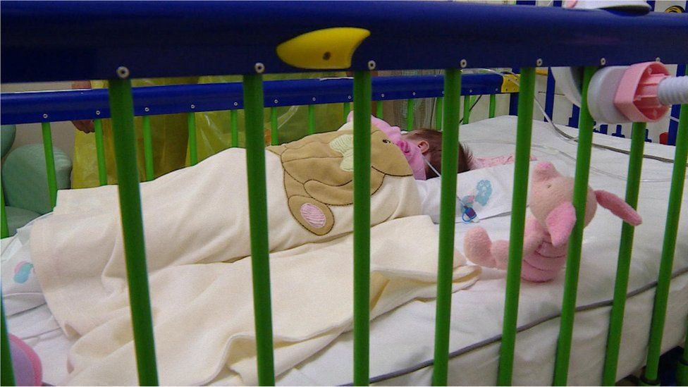 Baby Sophie in her cot