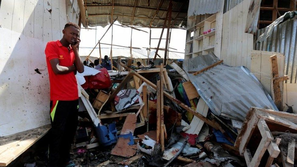 A Somali trader stands outside his destroyed shop near the scene of the explosion (19 February 2017)