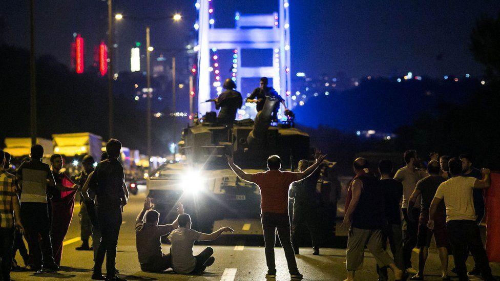 Turks take over a tank near the Fatih Sultan Mehmet bridge in Istanbul on July 16