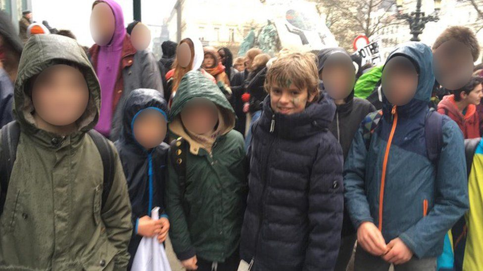 Isidore Vlassenroot, 12, at Thursday's march with friends