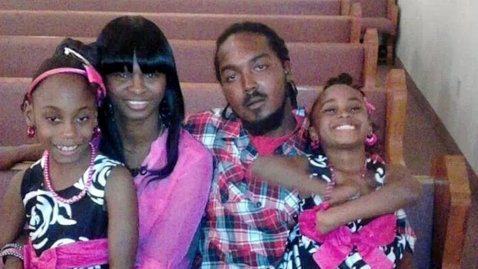 Gregory Vaughn Hill Jr with his fiancée and two of his children